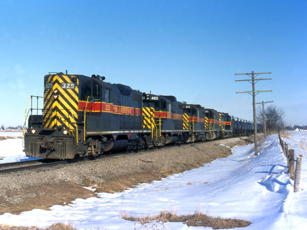 325 marches west with a Rock Island turn at Walcott, Iowa  March 13, 1999