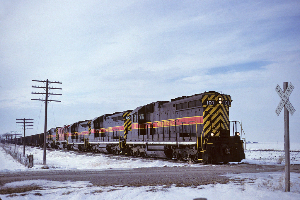 "101 runs long hood forward with an eastbound ""CRPE"" empty coal train at Walcott, Iowa January 20, 1999"