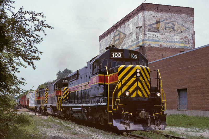 #103 shows up at Davenport, Iowa with an eastbound train for Rock Island Yard. 06/20/96.