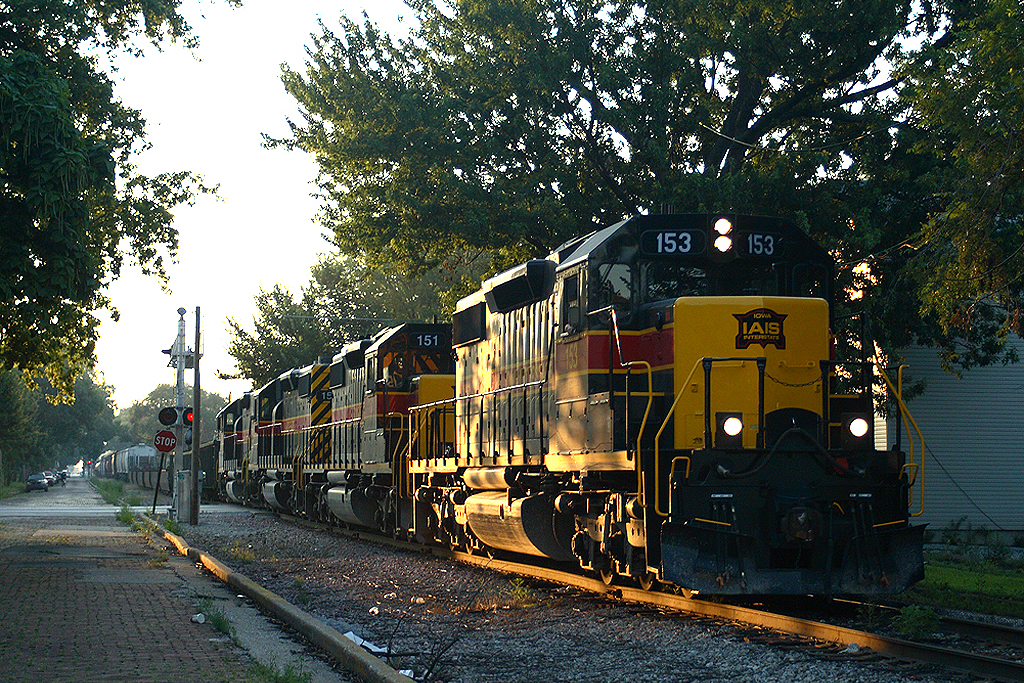 """153 leads the march up the hill at Davenport with the usual """"RIIC"""" train. July 29, 2006"""