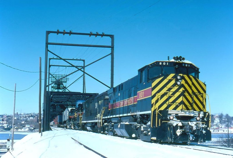 "801 crosses the Mississippi on a cold February 4th, 1996 with ""CBBI""."