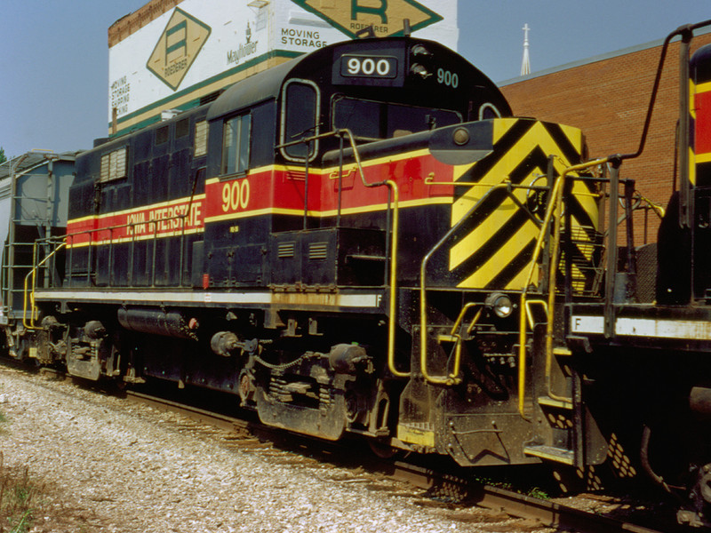 "900 makes it's final journey on the IAIS, seen here dead in tow on ""CBBI"" at Davenport, Iowa    August 27, 1999"
