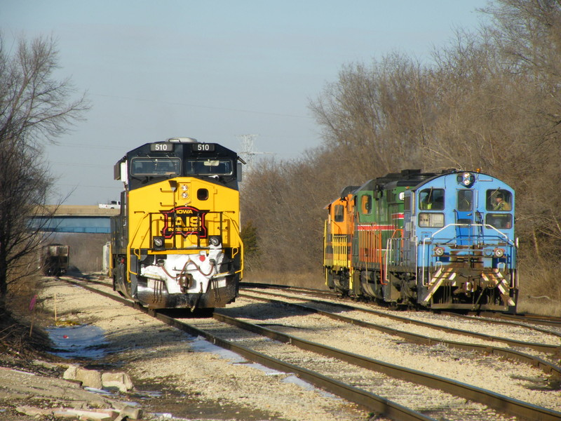 Iowa 510 heads down the main to tack on the rear of PECR as the trio of vintage EMD's begin to make their move toward track 2 to pick up their interchange from the Iowa.