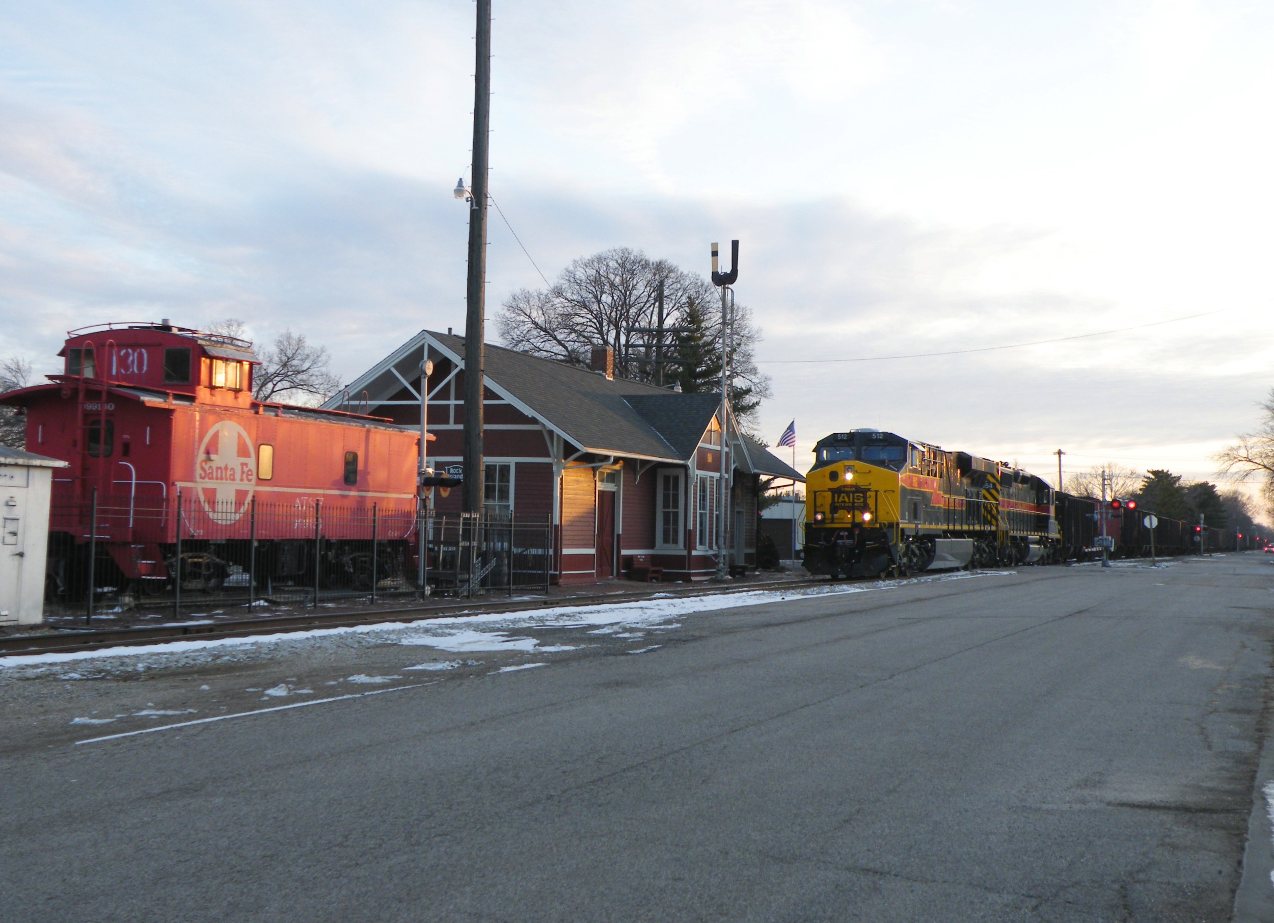 Iowa 512 has the coal train in control as they head back north passed the restored depot and caboose in Chillicothe.