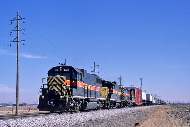 """A """"BICB"""" train blasts out of Davenport, Iowa with 628 leading the way on February 21, 2003."""