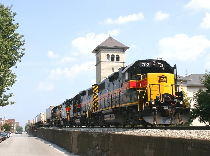 The west train cruises down 5th Street in Davenport, Iowa with 702 pointing the way  August 9 2005.