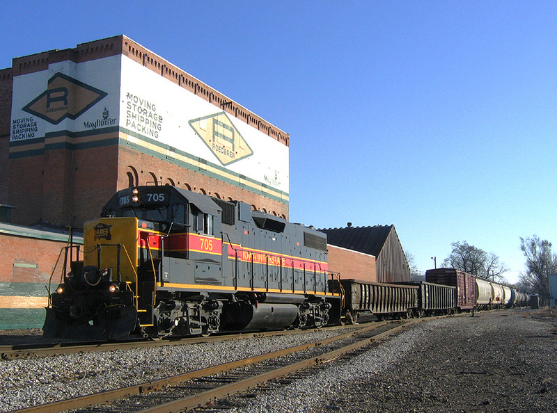 "A stubby ""BICB"" train is lead by lone 705, seen passing Missouri Division Junction at Davenport, Iowa  November 19, 2005."