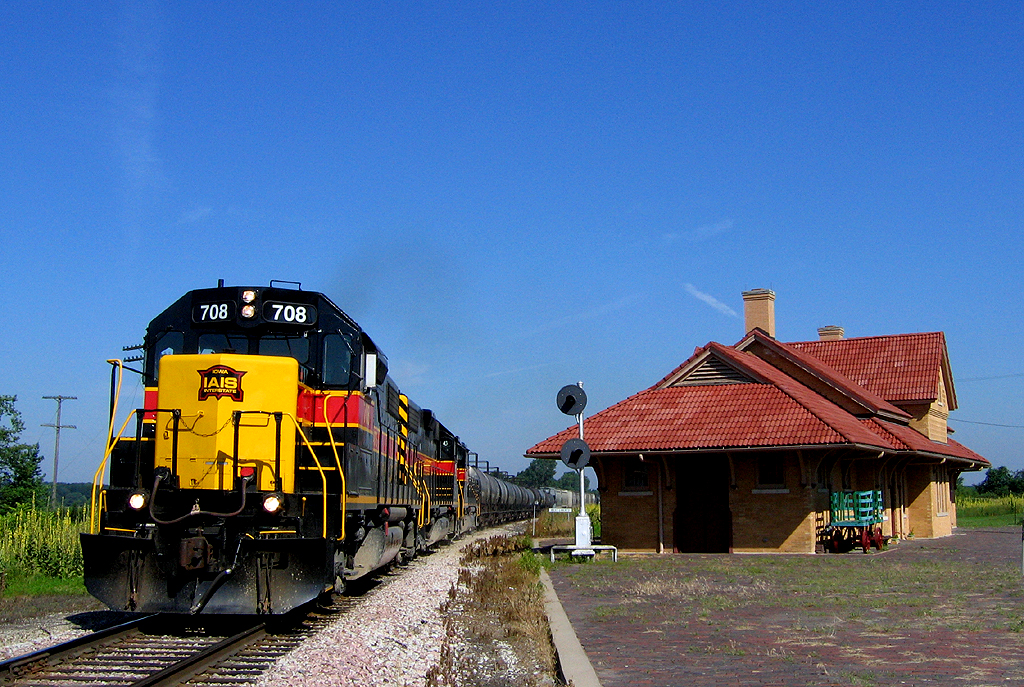CBBI passes the ex-RI depot at West Liberty, Iowa.  July 9th, 2006