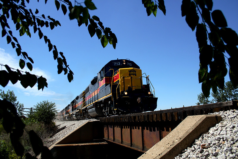 Just leaving Twin States, 713 brings the CBBI train near Durant, Iowa September 2nd, 2006.