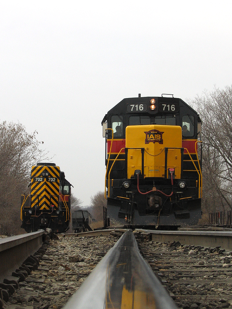 716 with a CBBI cools it's heels at Missouri Division Junction - Davenport, as 702 sits on the interchange track. February 28th, 2006