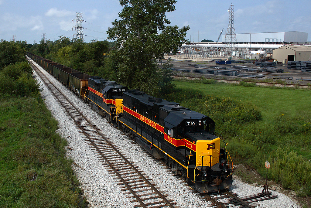 A CRPE empty coal bucket crawls through the North Star siding led by 719 at Wilton, Iowa August 21st, 2007.