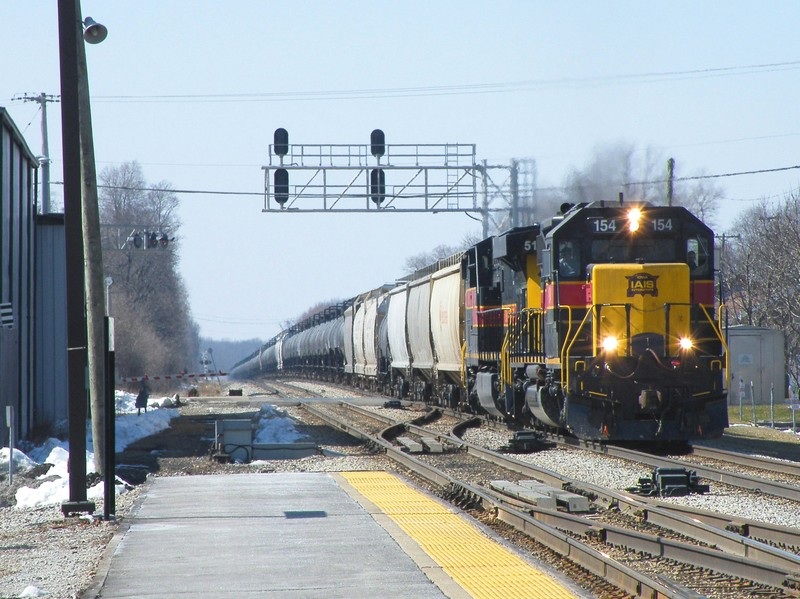 154 and 510 are down to a crawl as they lugg their heavy train up the grade into Mokena.