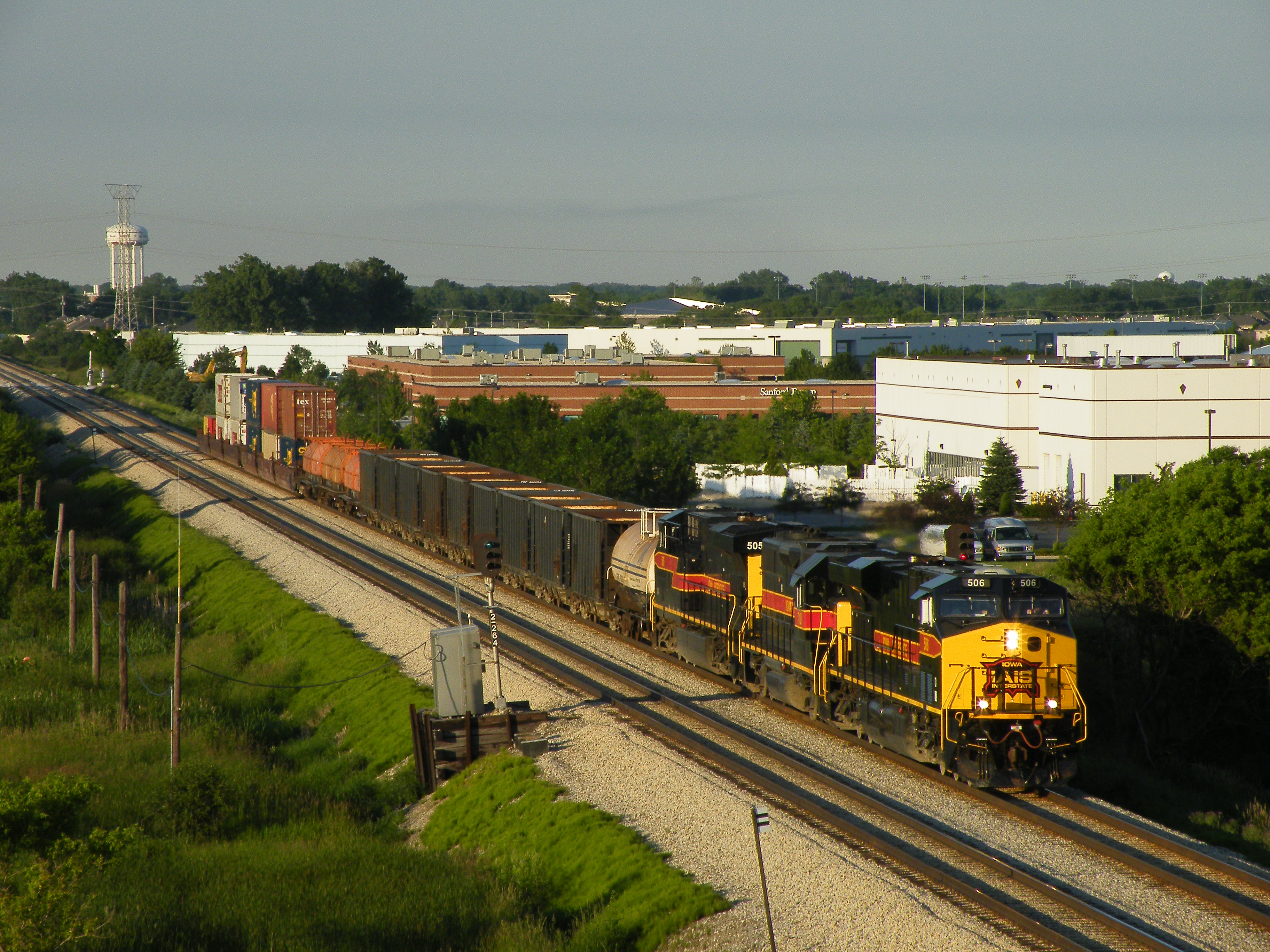 As viewed from I-80, Iowa 506 leads 710 and 505 on a comically short BICB through Tinley Park. I believe the train was missing its block of cars from the IHB, i.e. ethanol mtys and Crandic traffic. 06-07-10