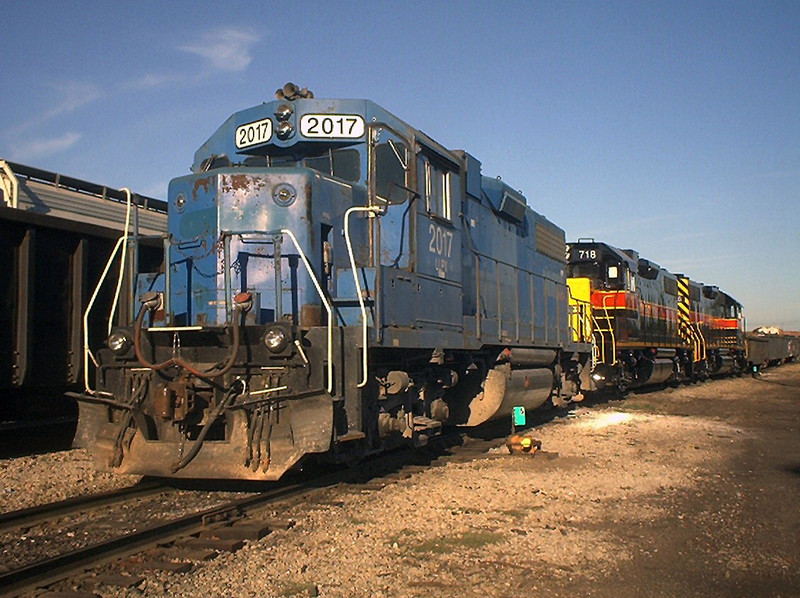 The 700s are starting to show up, and time is winding down on the era of the Blue Bombers. Here 2017 idles with a couple of IAIS's rebuilt horses at Rock Island, Illinois  August 11, 2004