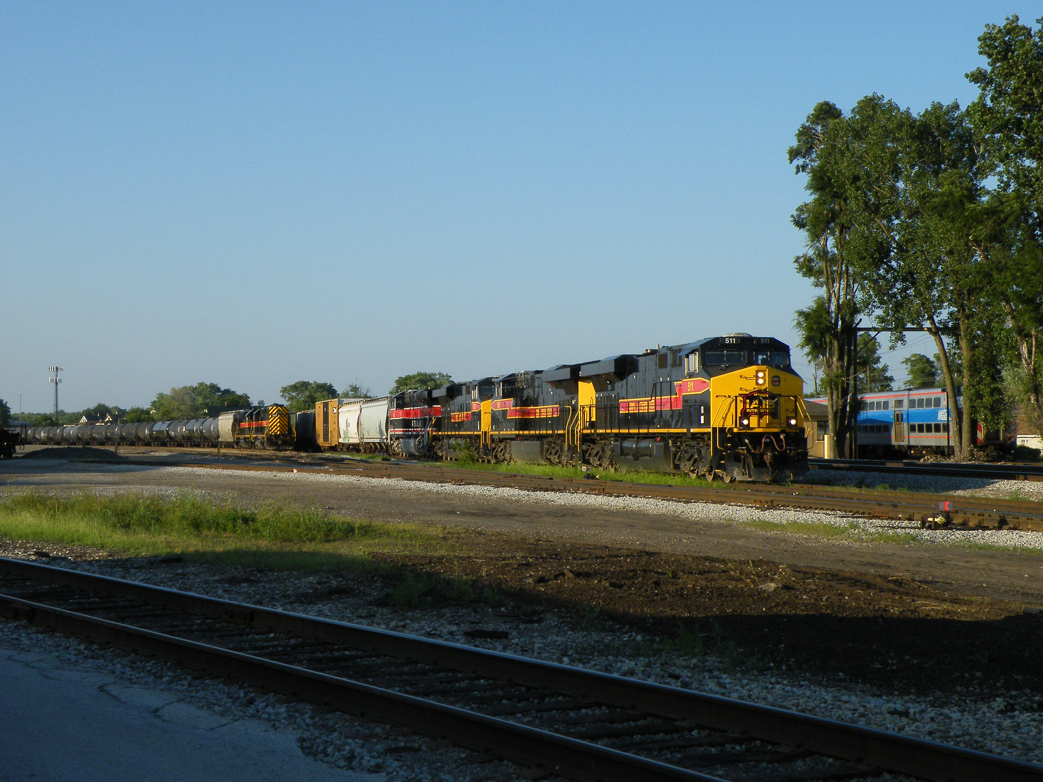 Iowa 511 is set to lead a lengthy BICB out of Burr Oak on this beautiful summer evening. The power tonight is four big GE's. Over on the left is a nifty little EMD consist for a BIRI type train later that evening. 07-16-10