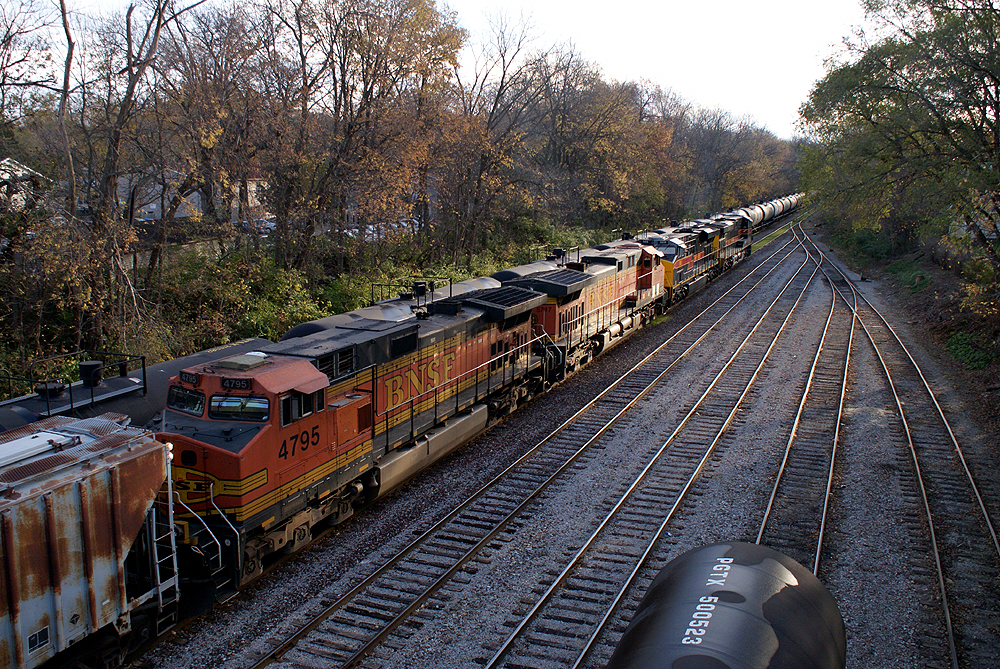 A pair of BNSF Dash9's on the CBBI passing through the Iowa City Yard.