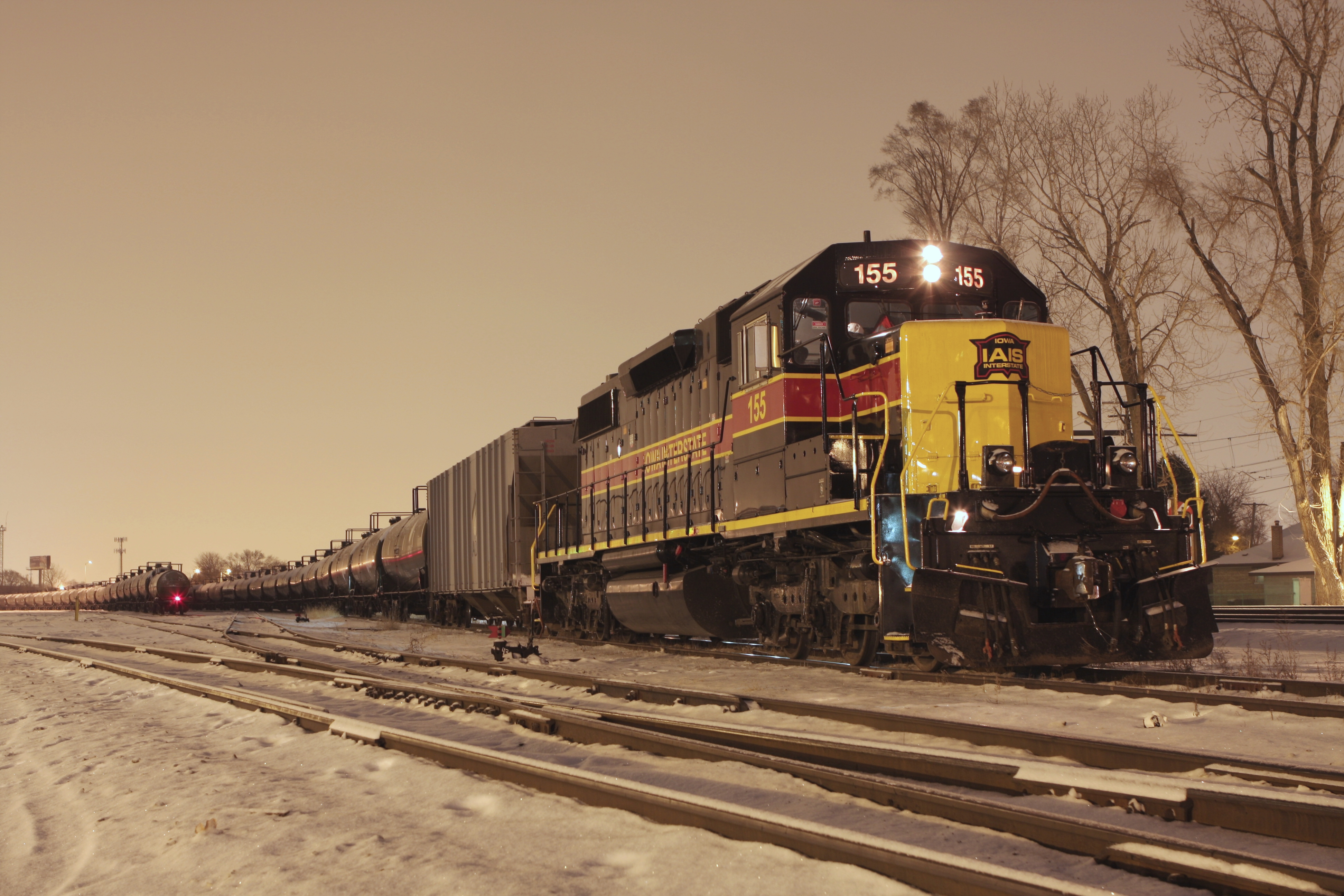 An inbound ethanol load is waiting to be handed off to the CRL, while an outbound empty ethanol train is ready to depart behind the 155. 12-17-10