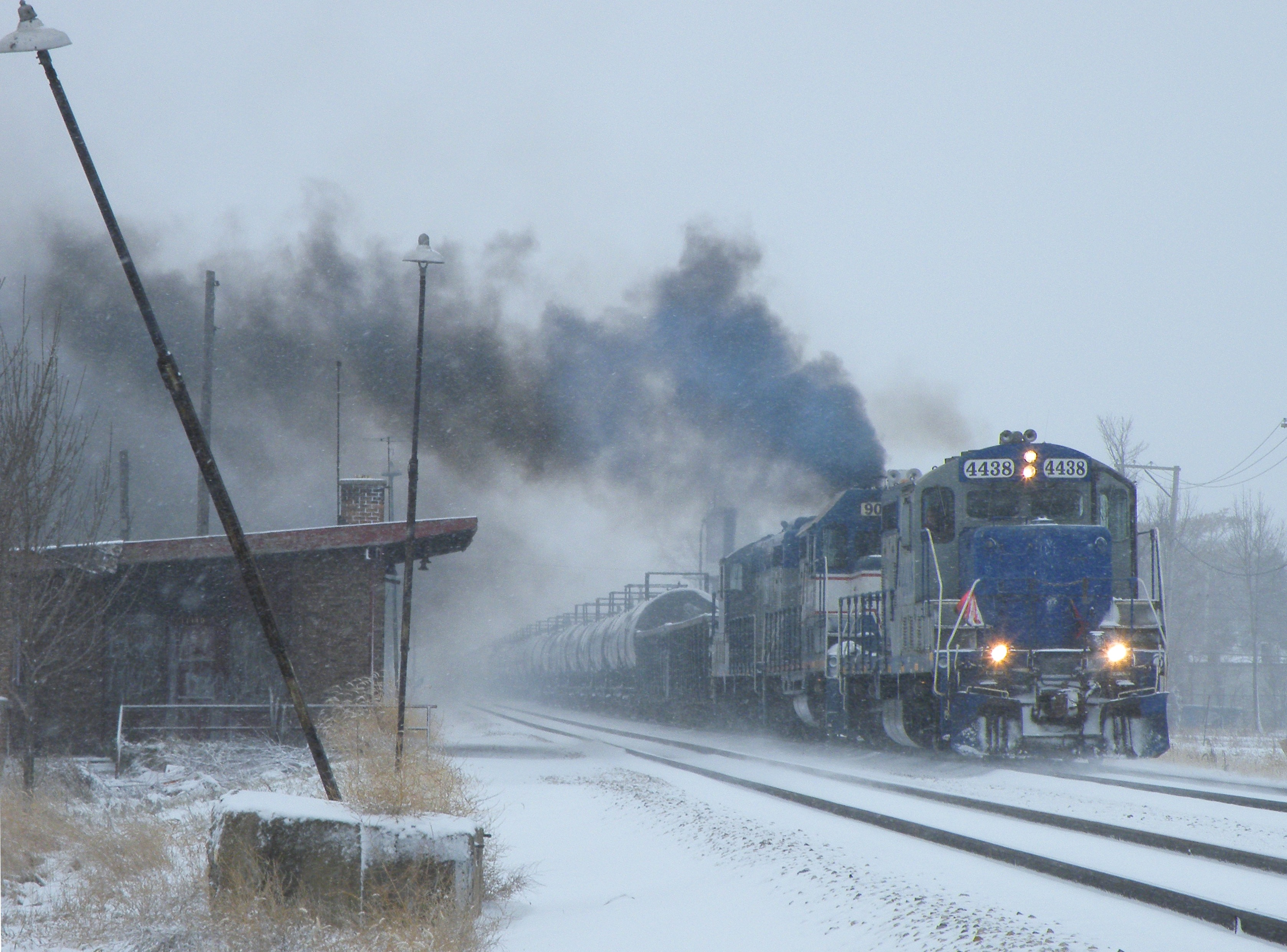 The RailLink has their interchange from the IAIS in tow, and are thundering north down the Rock main passed the old and decrepid 111th St Depot. 12-12-10