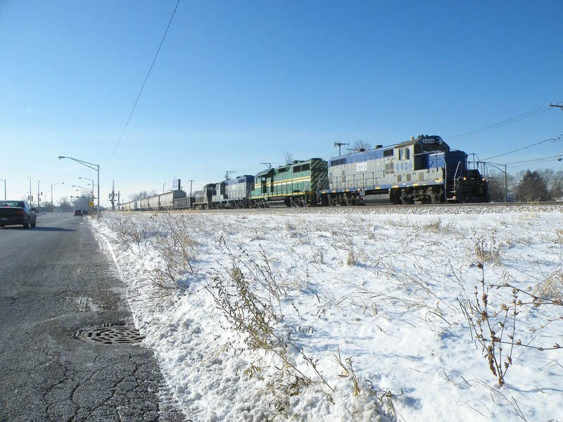 Pulling up to complete their airtest at 111th St., todays train from the Iowa is another giant 160+ car monster. With a nice rainbow lash-up to boot! 12-15-10