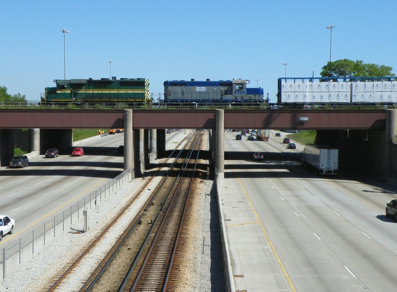 "Crossing over the Dan Ryan, the old Rock Island logo can be seen to the right, painted over with a ""Chicago Rail Link"" named sheet of steel bolted over it... 05-19-10"