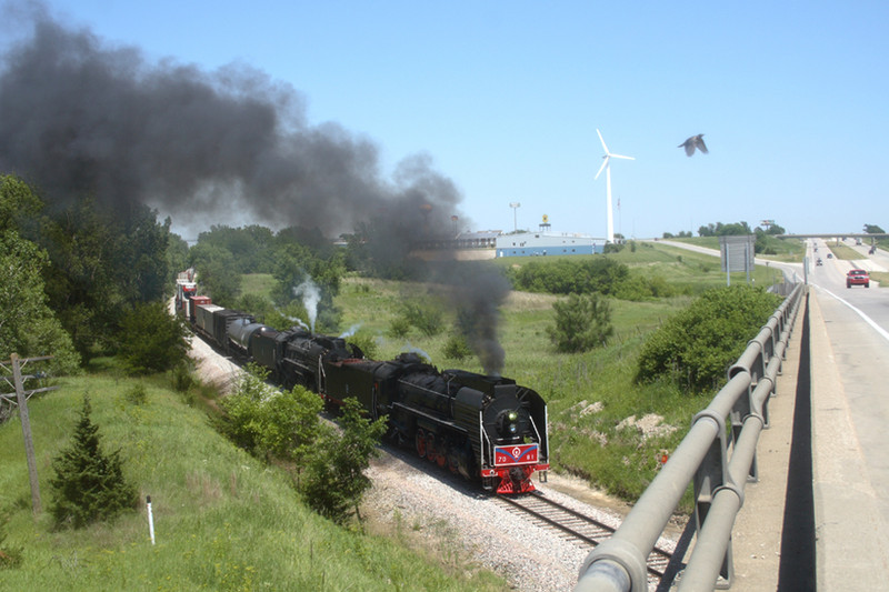 Three ways to fly. Chinese steam, cruising on I-80 or being a pheasant. Photo at Adair, Iowa.