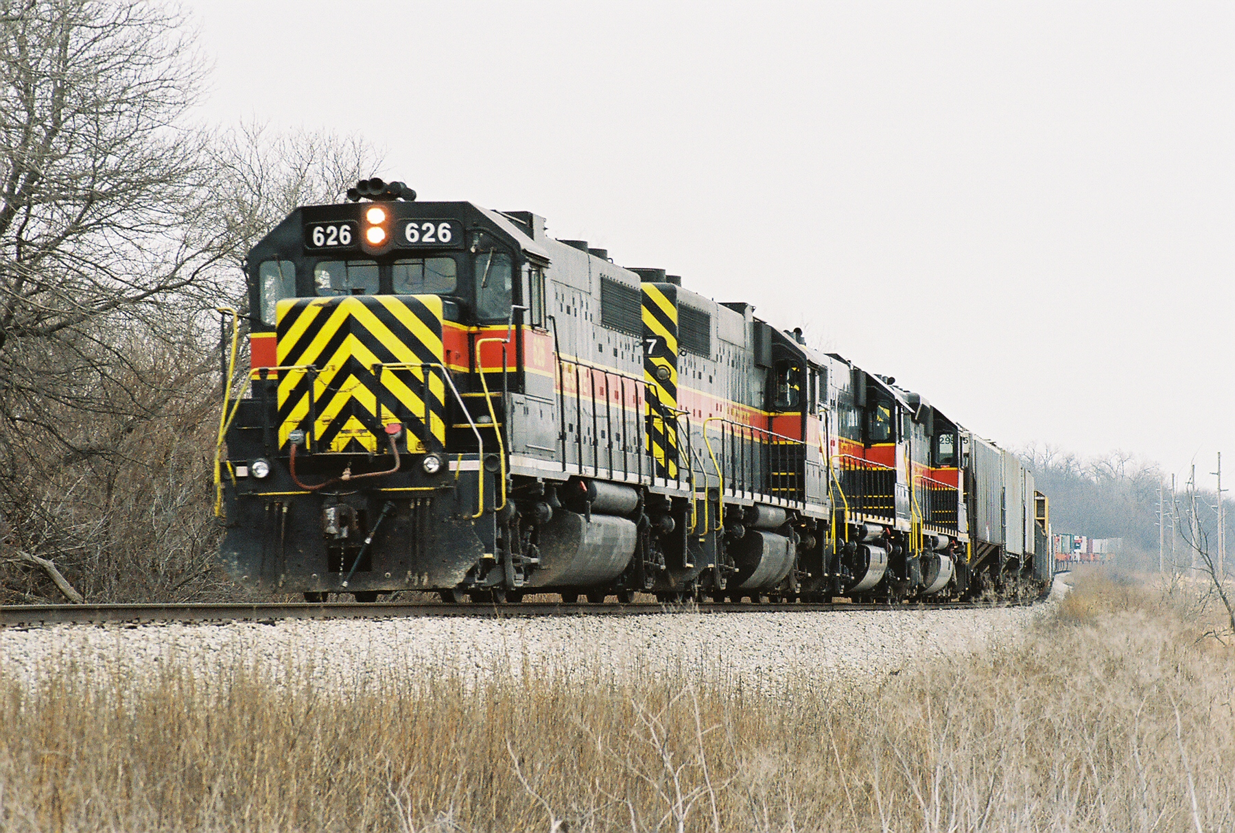 626 leading three units approaches the crossing east of Oxford, Iowa in this mid December 2006 photo.