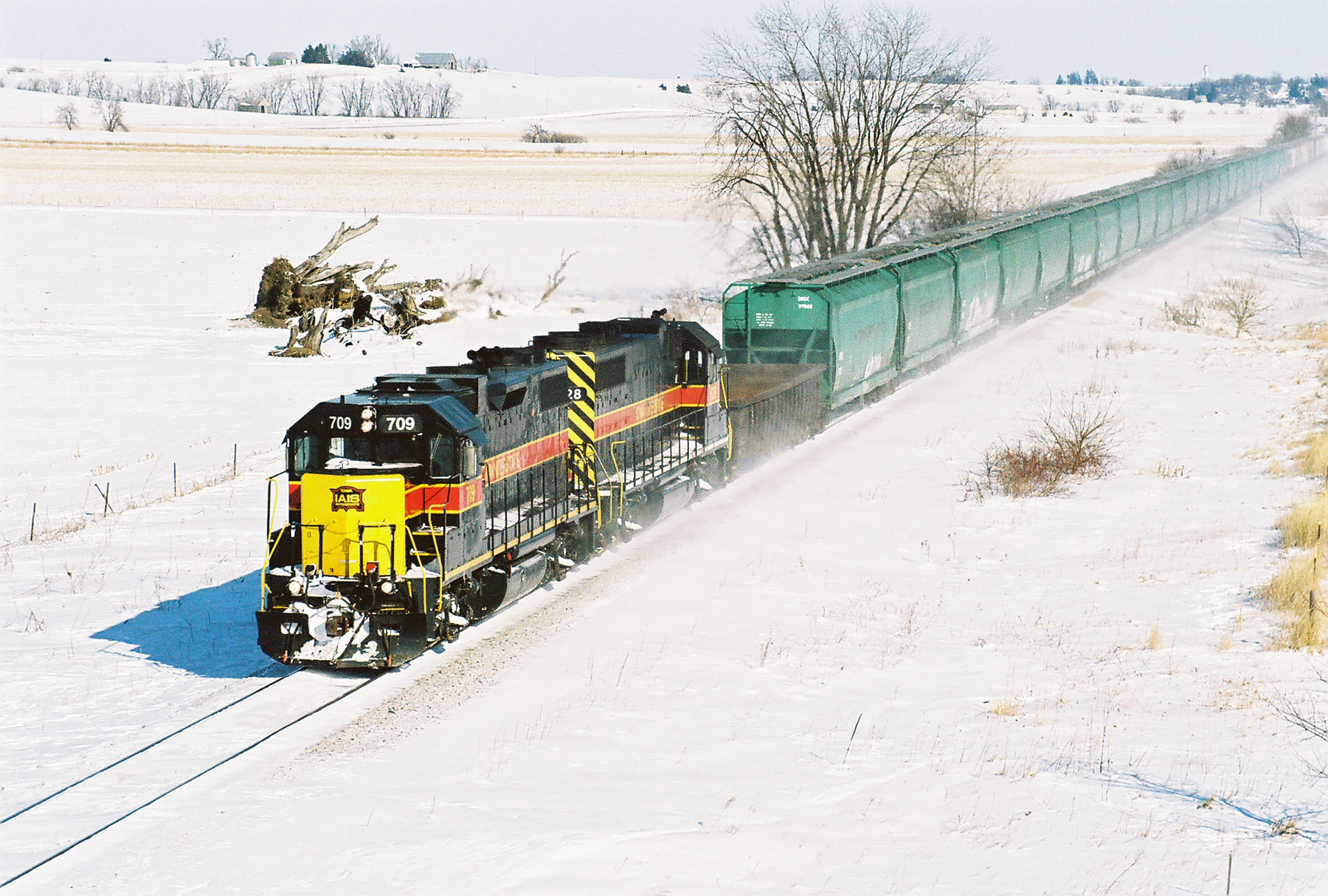 709 followed by 24 Inobrasa hoppers drags the BICB under the Highway 6 bridge west of Ladora, Iowa on February 10, 2008.