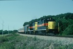 GP's 402 and 405 lead the Ag Expo east of Oxford Iowa on the way to the Farm Progress show held in Main Amana September 8, 1988.