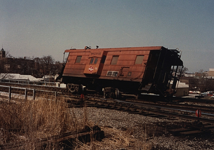 The result of a Milwaukee steel side caboose parked to close to a switch.