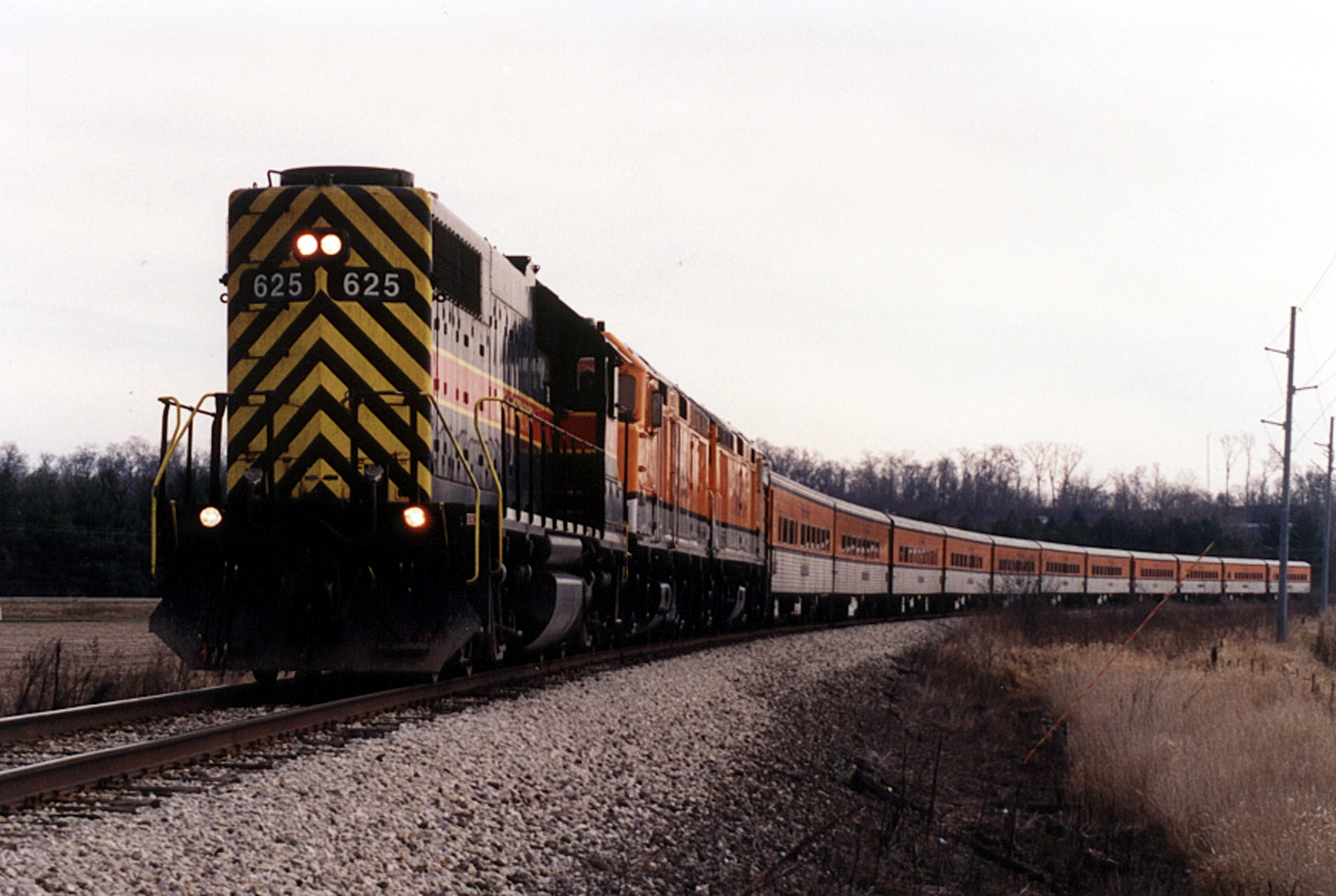 The Hawkeye Express Ski Train leaves Coralville/Iowa City for the last time in late November of 2005 with GP38 625 running long hood forward. West of Tiffin. Iowa.