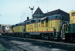 306 and 300 along with two other geeps moves frieght in Iowa City. 20-Aug-1986.