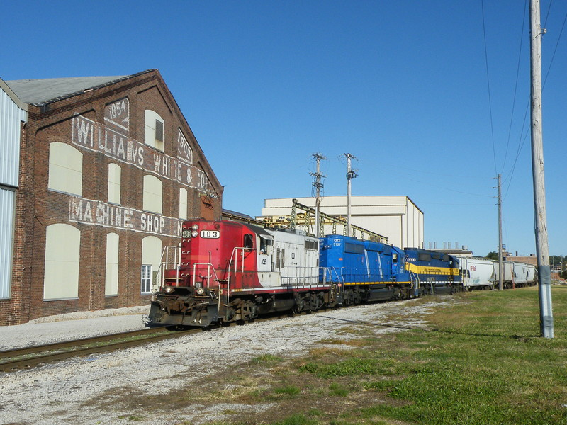 Coming into Rock Island, CP B73 passes the old Machine Shop building. 09-30-10