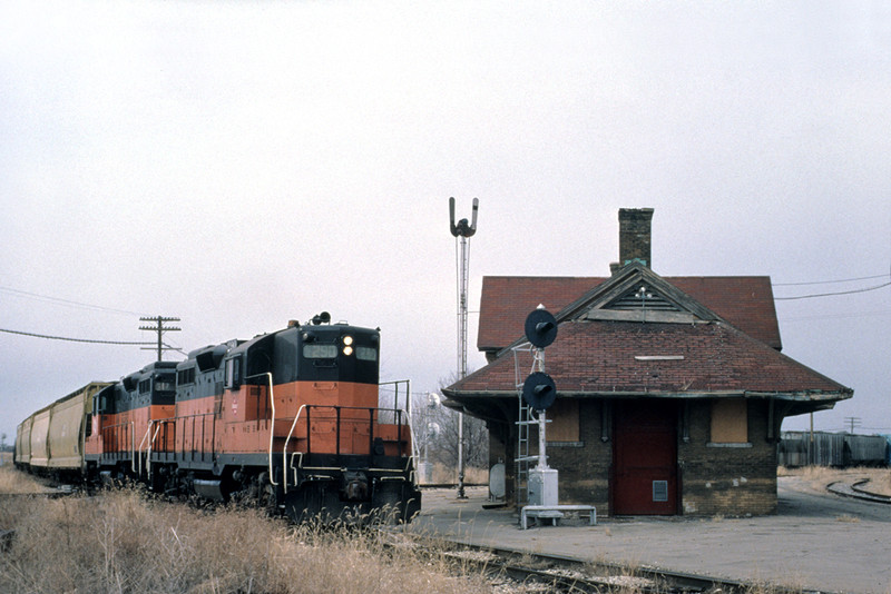 An eastbound MILW freight slaps the diamond of the still intact BCR&N main at West Liberty, March 1981. John Dziobko photo.