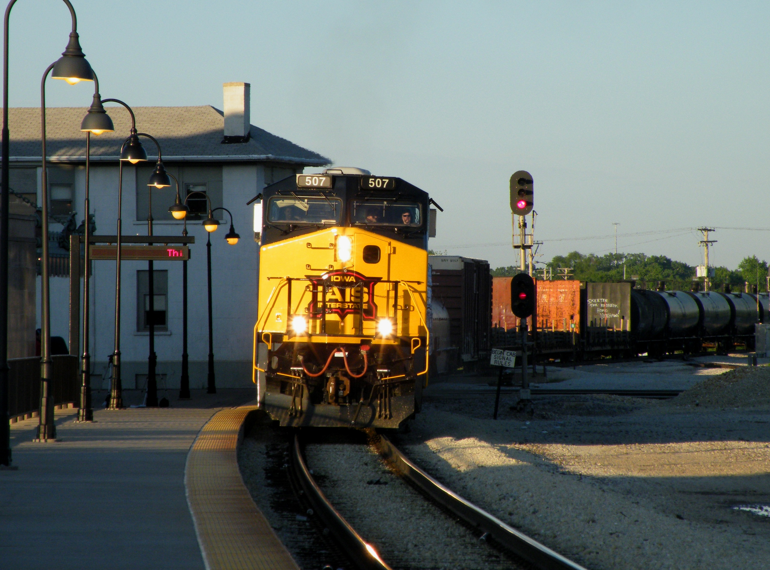 Iowa's 507 has found a sun spot as the train plops across the diamonds and slows for CSX's Bridge 407. 06-14-09