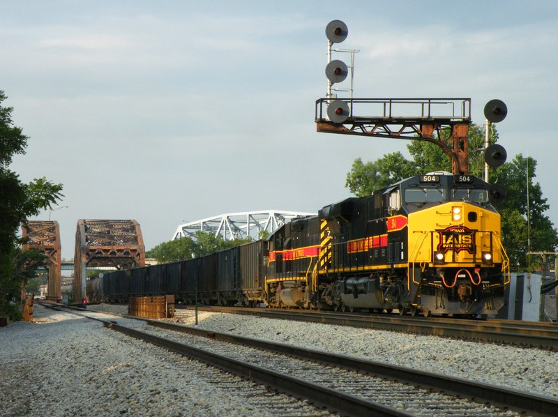 Iowa 504 leads GP38-2 703 on the daily BICB out of Burr Oak yard as they glide across the Cal Sag Channel leaving Blue Island. 07-22-09