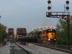 Just as the sun hits the tree line, BIRI blasts off with another pair of GP38-2's and a solid ethanol trainset from the CRL/NS, 05-16-08