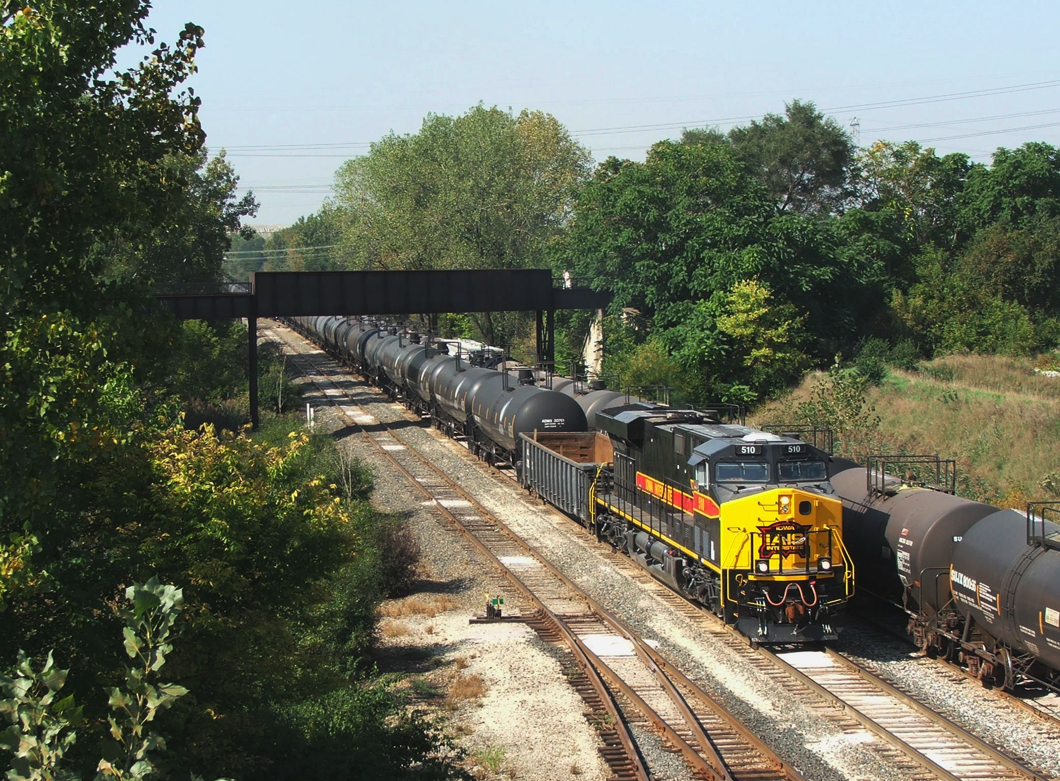 Iowa 510 creeps under the old Joliet Junction with permission from Bridge 407 to start em up.