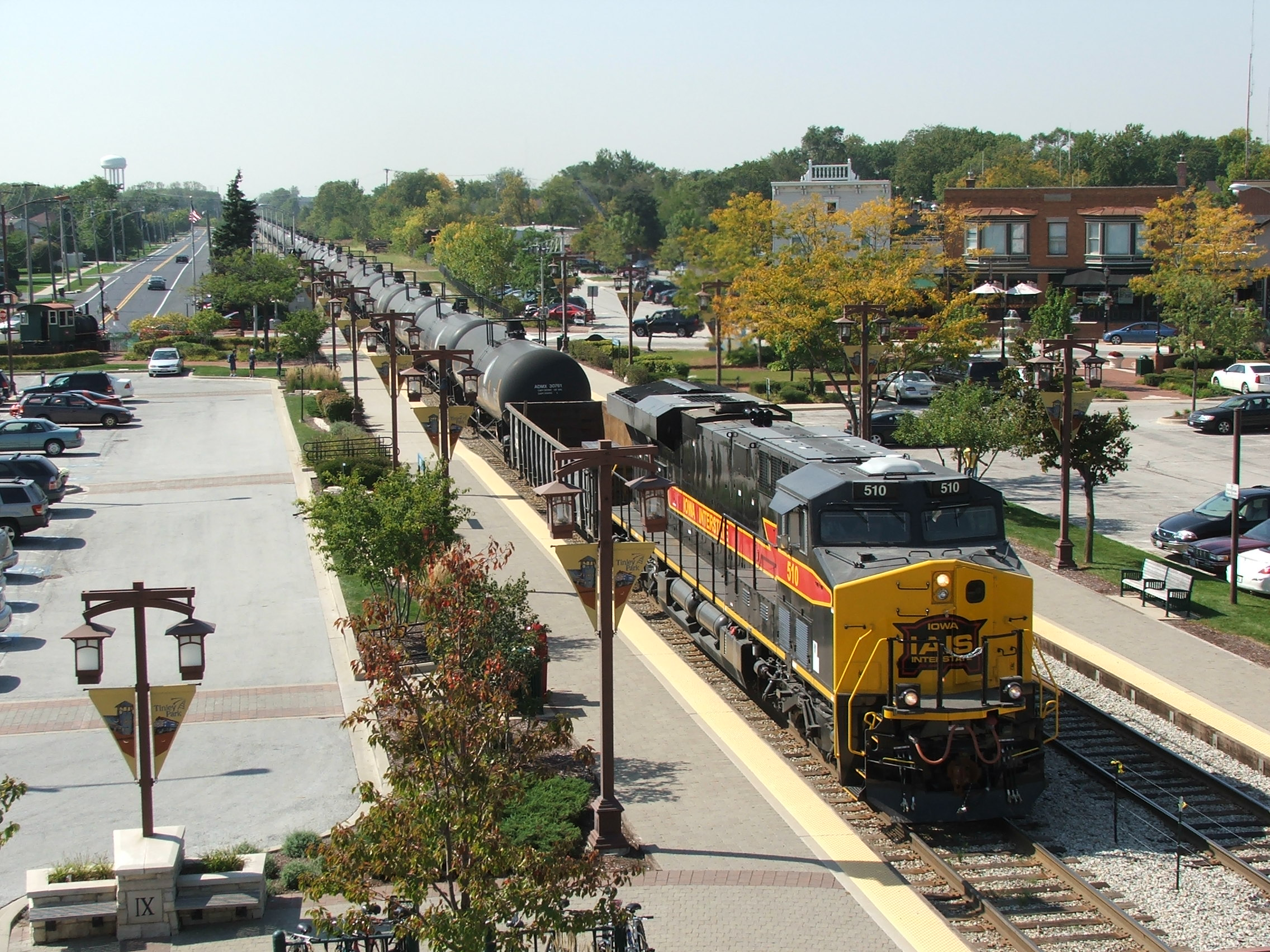 After holding at C.P. 66th Ct for the westbound Metra to cross-over, Iowa 510 and DPU 502 are in Run 8 building speed toward BI. Shot was taken from the Tinley Park clock tower.