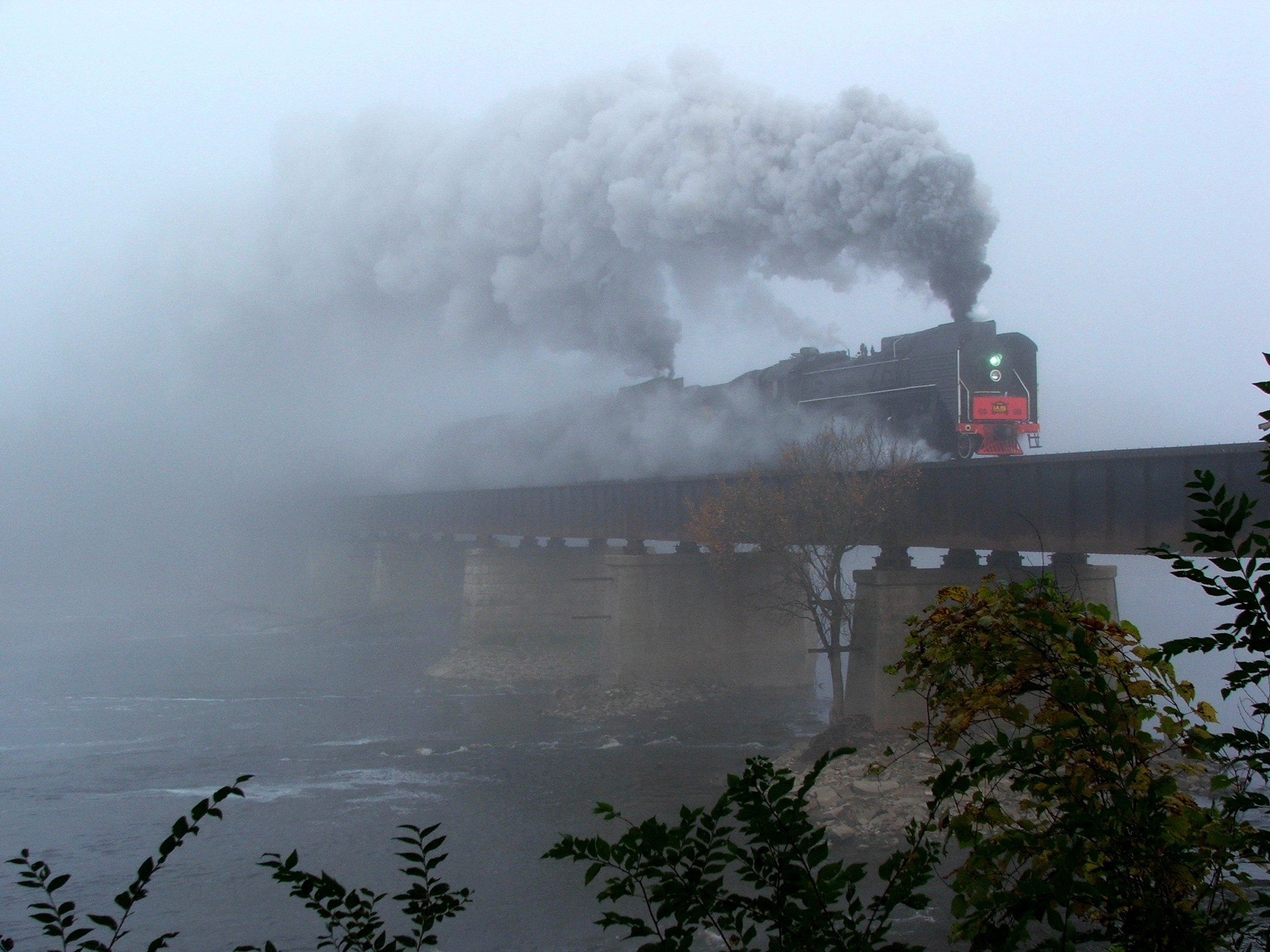 The two steamers emerge from the dense fog and into Moscow as they chug across the Cedar River.