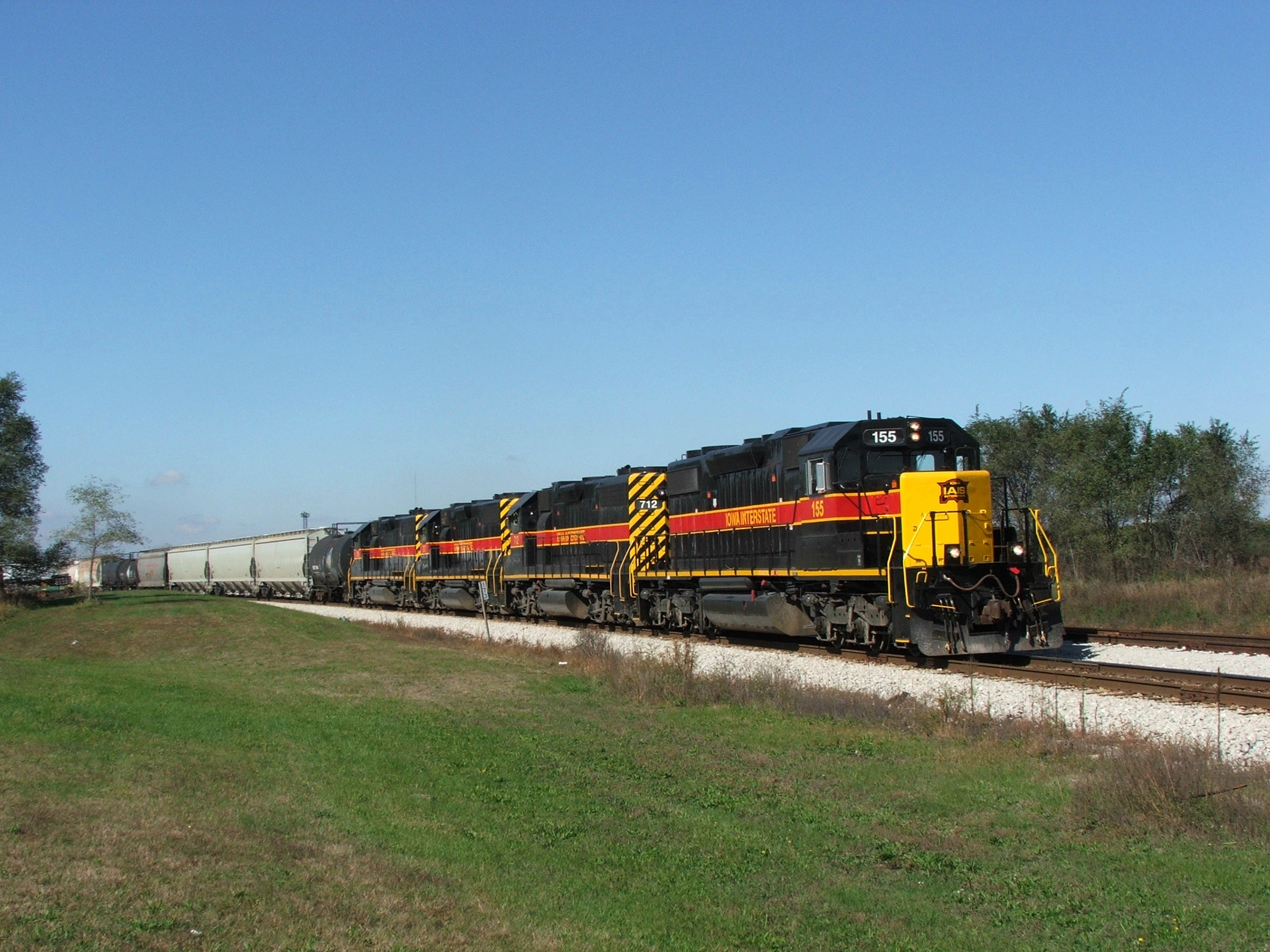 Iowa 155 pulls east through Silvis as they make a pick up at the east end of the siding. This was a rediculously early CBBI, they ran it early to keep it out of the way of the steam specials.