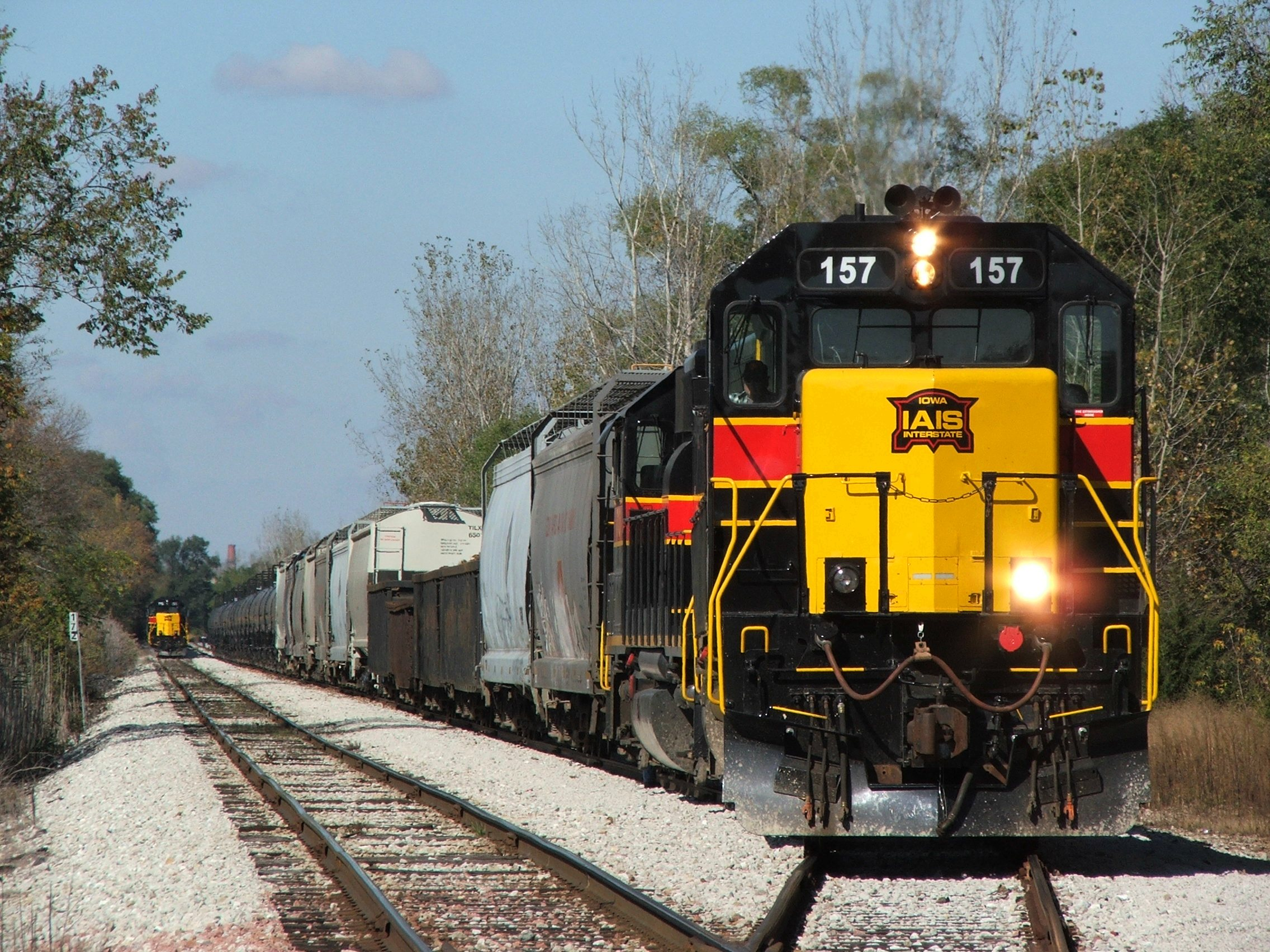 BUSW with 157 builds his air in the siding while CBBI with 155 holds the main. the CBBI will follow the BUSW east. Two SD38-2's on the point after chasing the QJ's across Iowa, can't get much better!