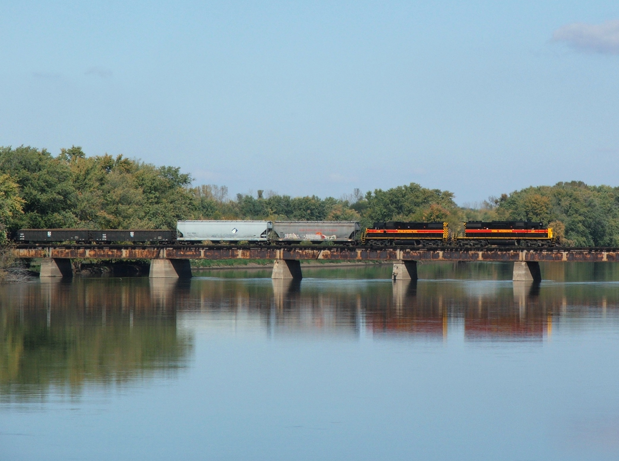 BUSW Iowa 157 heads over the Rock River as they bring the short train into Colona, IL.
