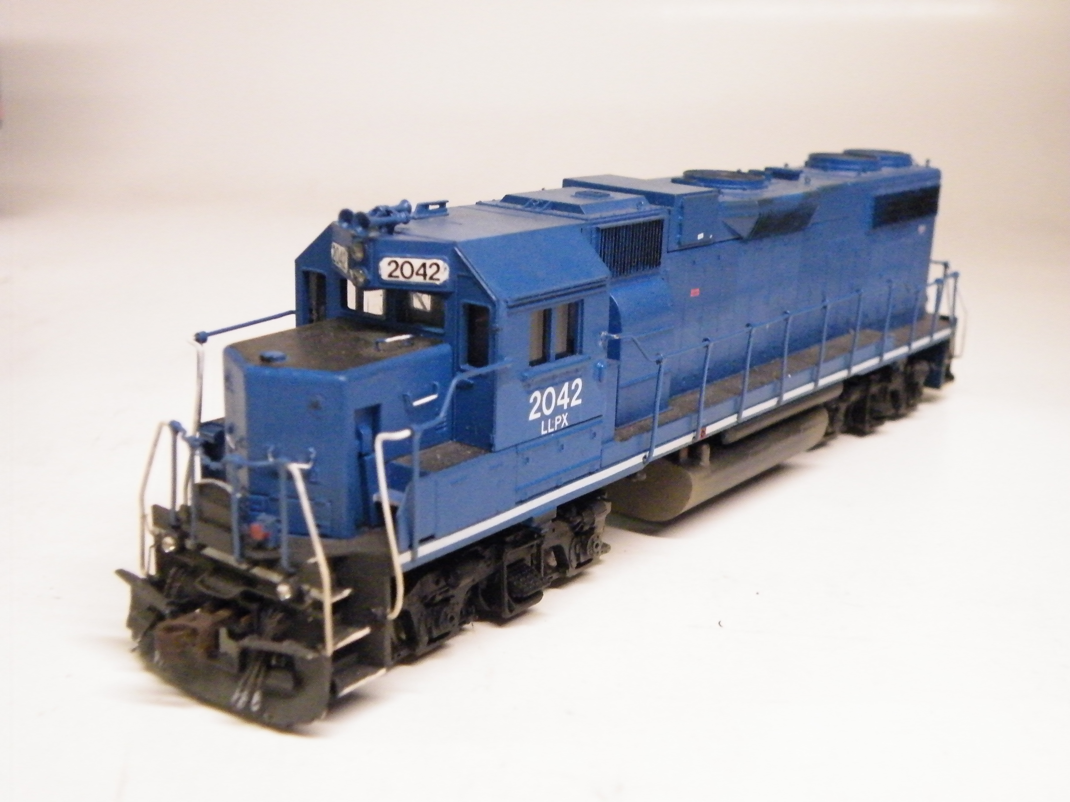 LLPX GP38 2042 was originally a Athearn Blue Box EMDX former Conrail unit that I patched while bored one day. This was my first custom project and was completed back in 2006.  I used the basic list of detail parts, nothing too special.