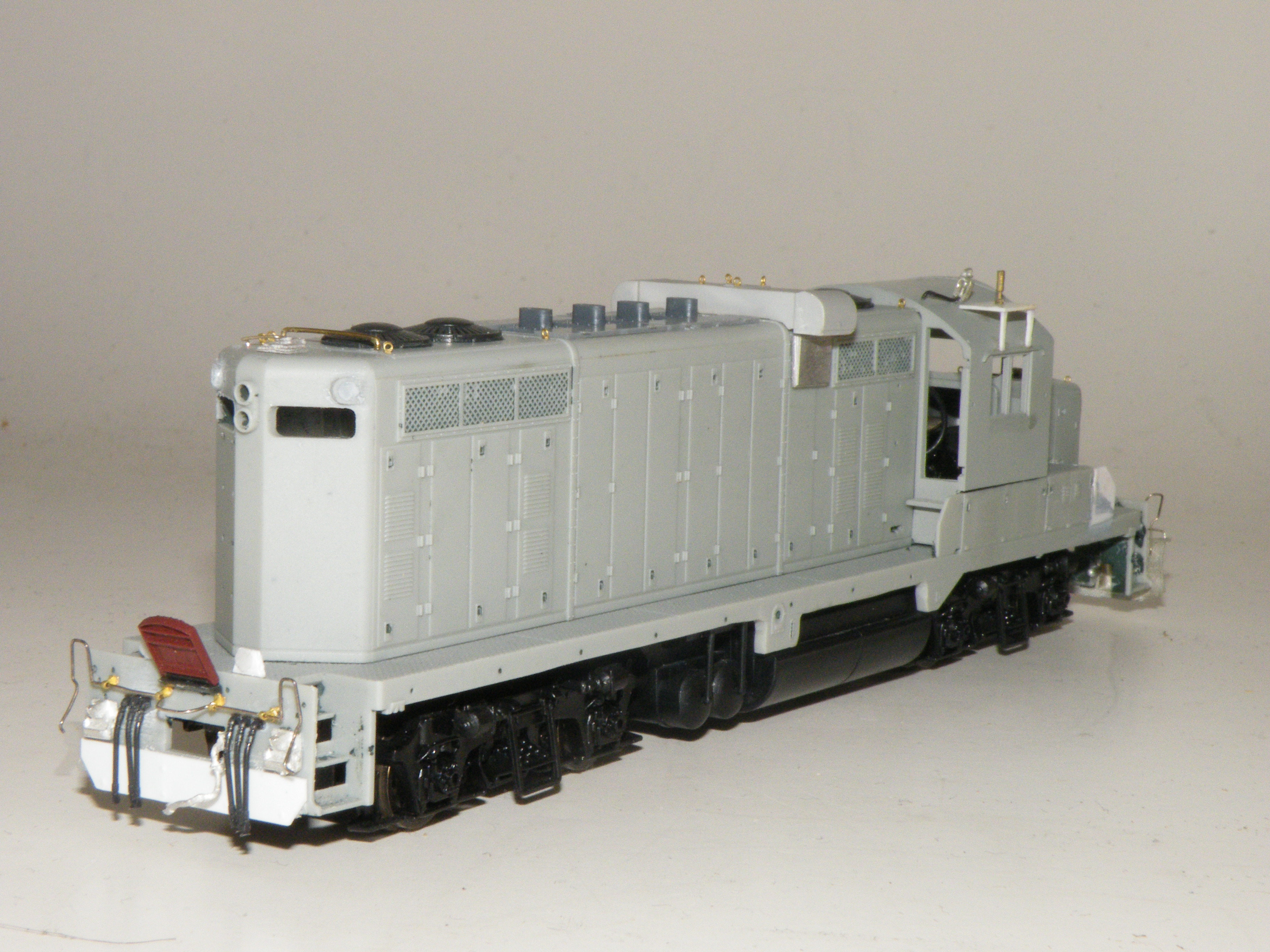 The rear view of 400 showing new styrene pilot and filled in class lights. I replaced the P2K exhaust stacks with four detail associate stacks. The only thing missing at this time were the doors, but I am now detail painting and decaling the nearly completed unit.