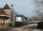 ICCR with IAIS 155, 152, 154, and 150 departs Iowa City passing the restored RI depot at the west end of town.