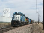 ICCR thunders through Coralville, IA with a set of four SD38-2's and a monster train of ADM traffic.