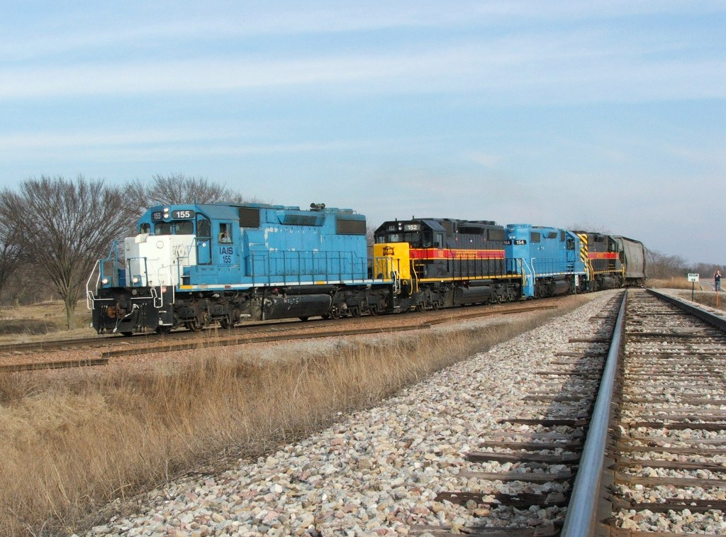 The four SD38-2's lean hard into the Yocum wye as they begine to turn back east heading for Cedar Rapids. This connection has a wicked super elevation.