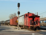 Iowa's only cupola caboose heads west into the sunlight leading BISW out of Burr Oak Yd. 04-16-07