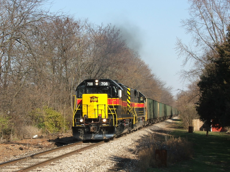 Clear of the slow order, the two GP38-2's smoke it up through the small town of Coughlin, IL