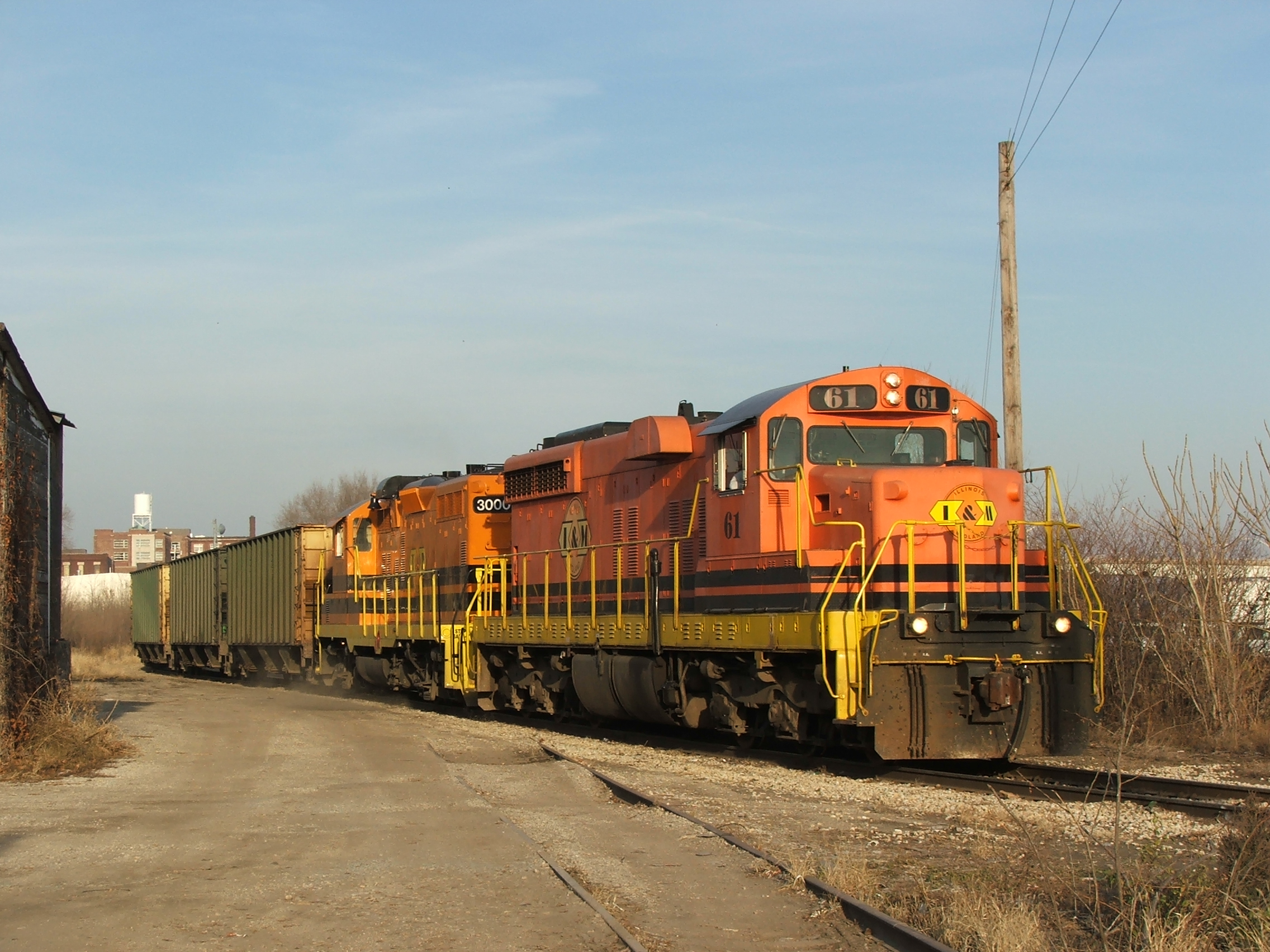 The TZPR coal train heads through the industrial East Peoria landscapes...
